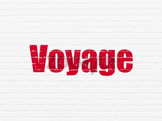 Vacation concept: Voyage on wall background