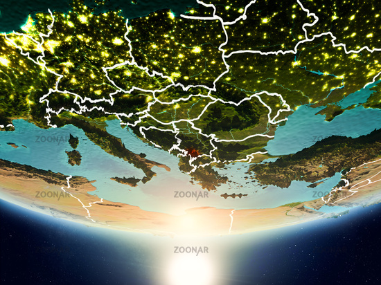 Kosovo with sun on planet Earth