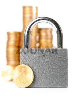 lock and coins, isolated on white