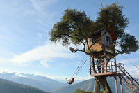 The Swing At The End Of The World Located At Casa Del Arbol, The Tree House In Banos De Aqua Santa, Ecuador, South America