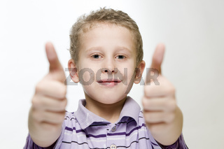 boy show two thumbs up wide
