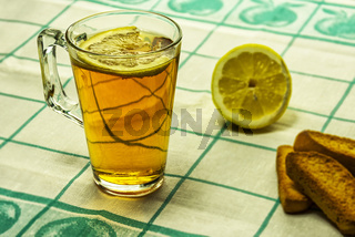 A glass of tea with lemon and vanilla breadcrumbs