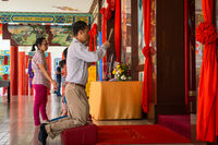 People pray at the front of praying hall in Chinese Thean Hou Temple