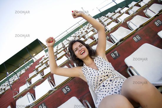 Retro cheering girl in stadium