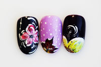 three plastic tips for nail extension and training in applying design while training a manicure on a white background. trial student work in the form of maple leaf and flowers.