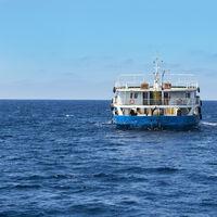 Cargo ship passes the strait