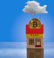 Toy bank building with bitcoin assets