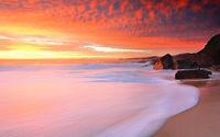 Foamy white seas and vivid sunrise
