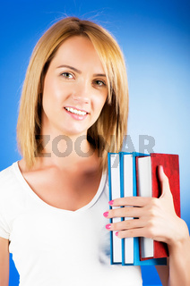 Young university student with many study textbooks