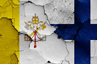 flag of Vatican and Finland painted on cracked wall