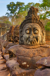 Stone carved statues of Devas in Cambodia