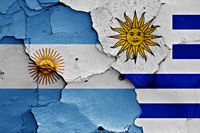 flags of Argentina and Uruguay painted on cracked wall