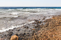 dirty beach near Aqaba port on Red Sea in winter