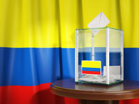 Ballot box with flag of Colombia  and voting papers. Colombian presidential or parliamentary election.