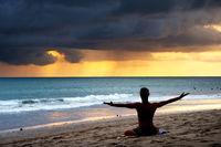 Man exercising yoga. Bali,  beach