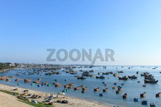 many fishing boats in Mui Ne harbor , Vietnam