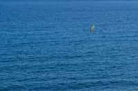 wind surfer far away on ocean aerial