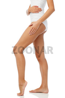 legs of beautiful young woman in white underwear