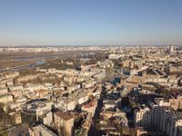 Aerial view of the city center of Kiev and Hydropark against the blue sky on a sunny day