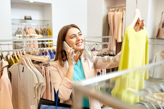 woman calling on smartphone at clothing store
