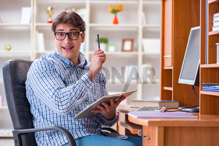 Young student at computer table