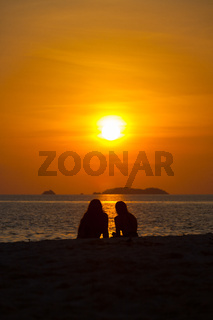 Two People Silhouette Watching Sunset Beach Ocean