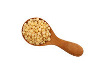 Ptitim Israeli couscous in wooden scoop on white