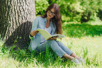 Woman reading a book in park
