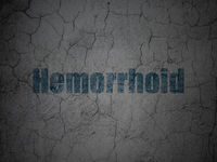 Healthcare concept: Hemorrhoid on grunge wall background