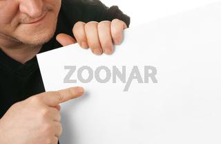Man holding white blank cardboard