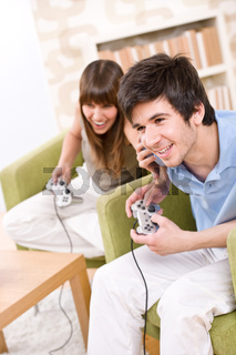 Student - happy teenagers playing video game