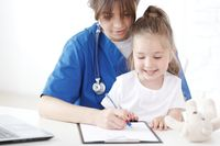Child patient and doctor