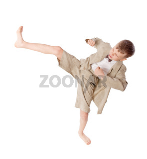 Boy does karate kick