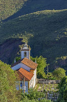 View of old church in the city of Ouro Preto with a graveyard beside
