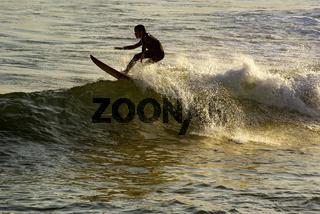 Boy surfing on Arpoador beach