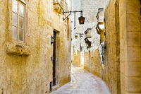Street with traditional maltese buildings in Mdina
