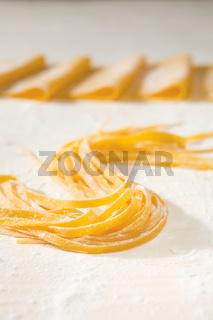 Fresh uncooked tagliatelle pasta