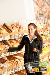 Grocery store: Business woman choosing bread