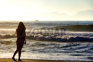 Girl at summer sunset