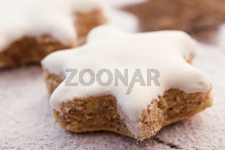 Star-shaped cinnamon biscuit with powder sugar as closeup