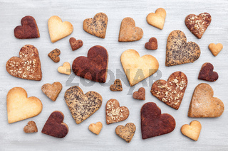 Love concept. Variety of heart cookies on grey rustic background