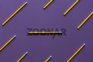Pencils with eraser tops on purple background