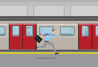 Man running to catch subway train.