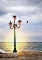 romantic sunset views with ancient pink lantern on Grand Canal in front of the Basilika San Giorgio Maggiore in Venice