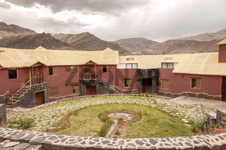 View of a traditional vintage hotel in Chivay, Arequipa Peru with clouds