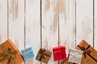 Christmas presents over a rustic wooden table