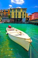 Peschiera del Garda colorful harbor and boats vertical view