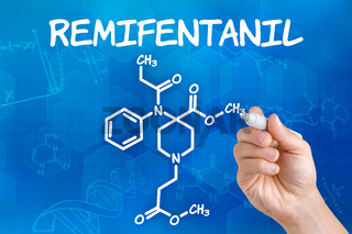 Hand with pen drawing the chemical formula of Remifentanil