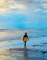 Silhouette of surfer. Bali island
