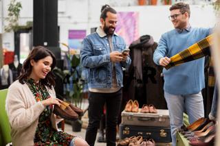 friends choosing clothes at vintage clothing store